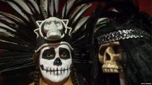 A performer wears a headdress with a skull at the Cinco de Mayo celebrations in Los Angeles