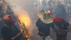 A firecracker goes off at a recreation of the battle of Puebla in Mexico City
