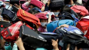School children take shelter during an earthquake drill in Seoul, South Korea