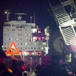 The bridge of the ship that crashed into Genoa harbour, the 'Jolly Nero', is clearly seen behind the wreckage of the control tower in this picture taken shortly after the collision, late on Tuesday, May 7, 2013.