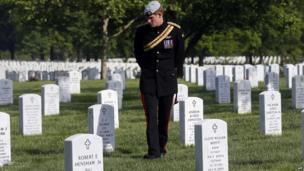 Prince Harry walking through Arlington cemetery