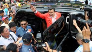 Former Philippine president Joseph Estrada waves to his supporters after casting his vote during mid-term elections in Manila