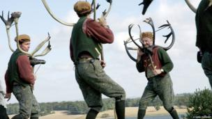 Abbots Bromley Horn Dancers performing on a local farm in Staffordshire