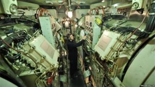 Royal Navy Engineering Technician Petty Officer Steve Frewer in the engine room of HMS Edinburgh