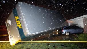A trailer landed on a car that was parked in front of a home in Cleburne, Texas after a powerful storm went through (15 May 2013)