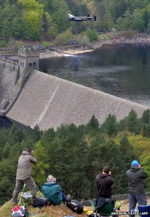 A Lancaster bomber flies over Derwent Reservoir in Derbyshire