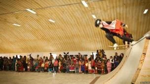 Girl skating in front of a crowd