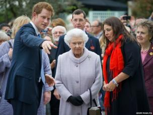 Prince Harry gives his grandmother, Queen Elizabeth II a tour of a garden at the Chelsea Flower Show in London