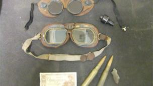 These objects belonged to Sub-Lieutenant D Whittick who served on board HMS Nairana from 1944 to 1946. Whittick was a Royal Naval Volunteer Reserve, 835 squadron of the Fleet Air Arm and flew Fairey Swordfish and Grumman Martlet on convoy escort duty to and from Murmansk in Russia.