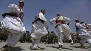 Afghan National Army soldiers dance, 23 May