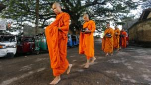 Buddhist monks parade through a street in Colombo, 23 May