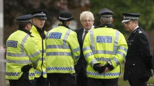 Boris Johnson speaks to police officers near the scene of the attack