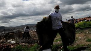 Volunteers in Pristina remove rubbish