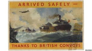 """A packing label which reads: """"Arrived safely – thanks to British Convoys"""". On the reverse the same message of thanks appears in different languages."""
