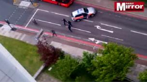 A still from video footage of the confrontation between armed police and the suspects