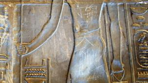 "Graffiti on ancient Egyptian artwork in Chinese reads ""Ding Jinhao was here"""