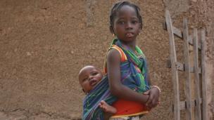 Child with baby. Photo: Alina Paul-Bossuet, Icrisat.