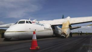 Damaged aircraft at an airport in Indonesia's East Nusa Tenggara province, 10 June 2013