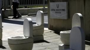 Toilet and tombstone installation outside the Central Bank of Cyprus in Nicosia, 10 June 2013
