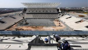 Employees work on the site of the Arena Sao Paulo stadium in Sao Paulo