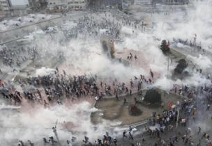 Protesters running from Taksim Square, 11 June 2013