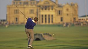 Scotland's Colin Montgomerie tees off on the 18th hole at the Old Course in St Andrews