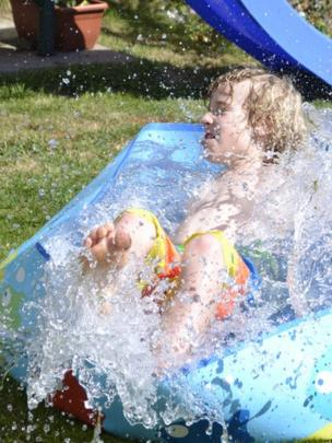 Boy in paddling pool