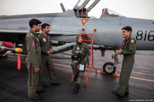 Ayesha Farooq beside a Chinese-made F-7PG fighter jet at Mushaf base in Sargodha, north Pakistan