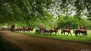 The King's Troop Royal Horse Artillery arrive to fire a 41 round Royal Salute in Green Park in central London