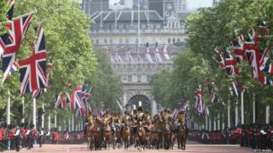 Guards march down the Mall towards Buckingham Palace during the annual Trooping the Colour Ceremony