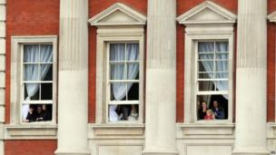 Members of the public watch from windows during Trooping the Colour, in Horse Guards Parade, London