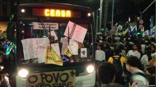 A bus is brought to a standstill by protestors in Sao Paulo, 17 June 2013