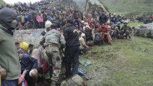 Members of the Indian Army gather stranded tourists and villagers who were rescued in the Himalayan state of Uttarakhand June 18, 2013