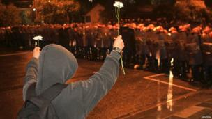 Demonstrator offers flowers to riot police in Porto Alegre, southern Brazil, on 20 June 2013