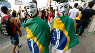 Demonstrators wearing Guy Fawkes masks in Recife city on 20 June 2013