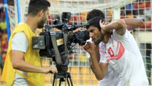 Tunisian footballer Oussama Darragi pulling a face in front of a television camera after scoring in Malabo, Equatorial Guinea - Sunday 16 June 2013