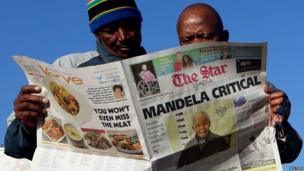 Reading newspapers in Soweto on 24 June 2013