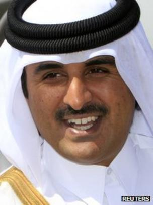 Qatar's Crown Prince Sheikh Tamim Bin Hamad al-Thani smiles during his arrival for a - _68361542_tamim