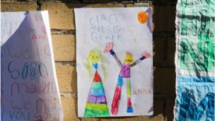 "A young child's poster in coloured crayon reads: ""Ciao Nelson Grazie"""