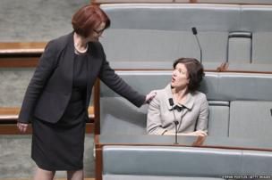 Former Australian prime minister Julia Gillard greets Kirsten Livermore in the House of Representatives in Canberra