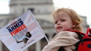 A child waves a flag at the Nottingham parade