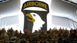 US soldiers attend a naturalisation ceremony at the US base in Bagram, north of Kabul, 4 July 2013