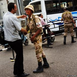 A man shakes a soldier's hand in Cairo, 4 July