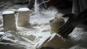 Sri Lanka workers make papadums or crisps at a makeshift factory in Colombo