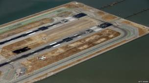 A Boeing 777 airplane lies burned on the runway after it crash landed at San Francisco International Airport on 6 July, 2013