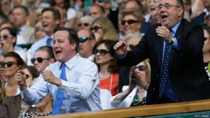 Wayne Rooney, David Cameron and Alex Salmond watching the match.