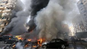 Smoke rises from burning cars at site of an explosion in Beirut's southern suburb