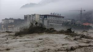 This picture taken on 9 July 2013 shows heavy flood waters sweeping through Beichuan in south-west China's Sichuan province