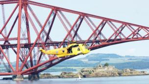 RNLI helicopter by the Forth rail bridge