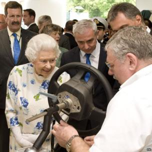 Queen Elizabeth II meeting Noel Thompson, a coach trimmer for Bentley cars